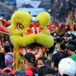 Dancing lion amidst the crowd of revelers during the Chinese New Year.