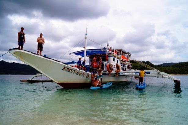 The expedition team on board the Tao boat. Photo credits: Roland & Aisha